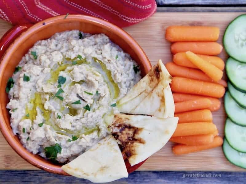 Baba Ganoush served with fresh vegetables and pita bread.