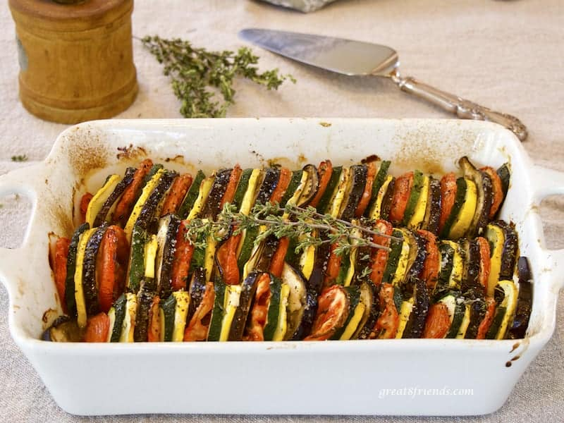 Provençal Vegetable Tian in rectangular casserole with herbs