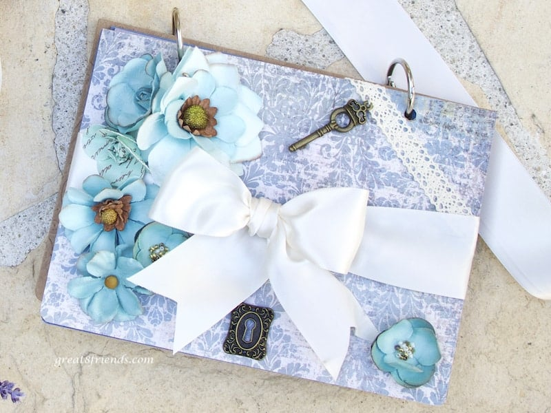"""Photo of front of invitation """"scrapbook"""" for Provence dinner party."""