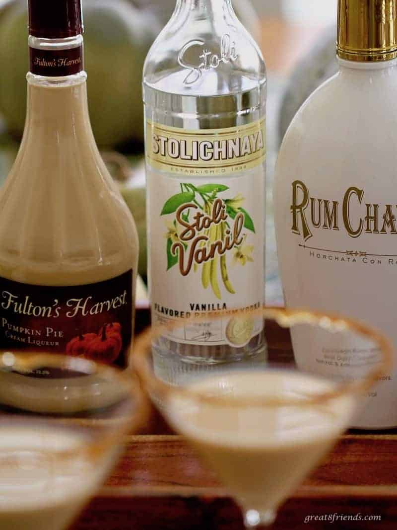 Bottle of Pumpkin Pie Liqueur, vanilla vodka and Rum Chata to make a pumpkin martini.