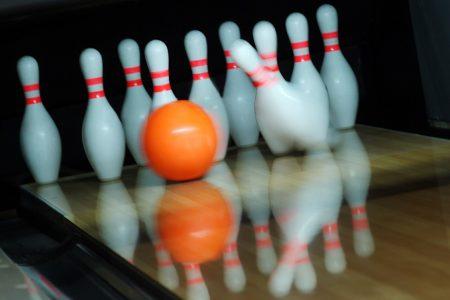 bowling lane, pins, and ball