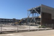 Security Fences are up as Excavators Head West in Wausau Center Mall Demolition