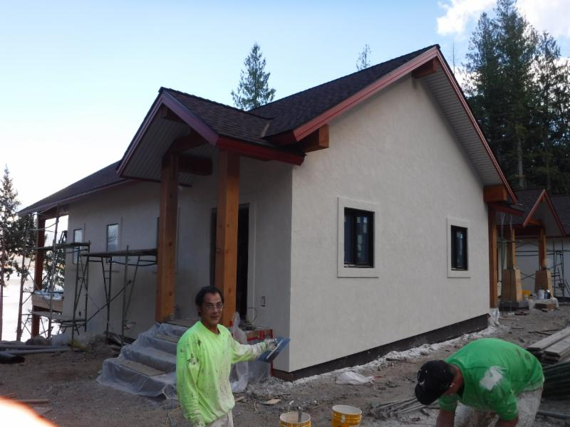 A faux stucco finish is applied over the foam board to complete the  Exterior Insulated Finish System (EIFS).