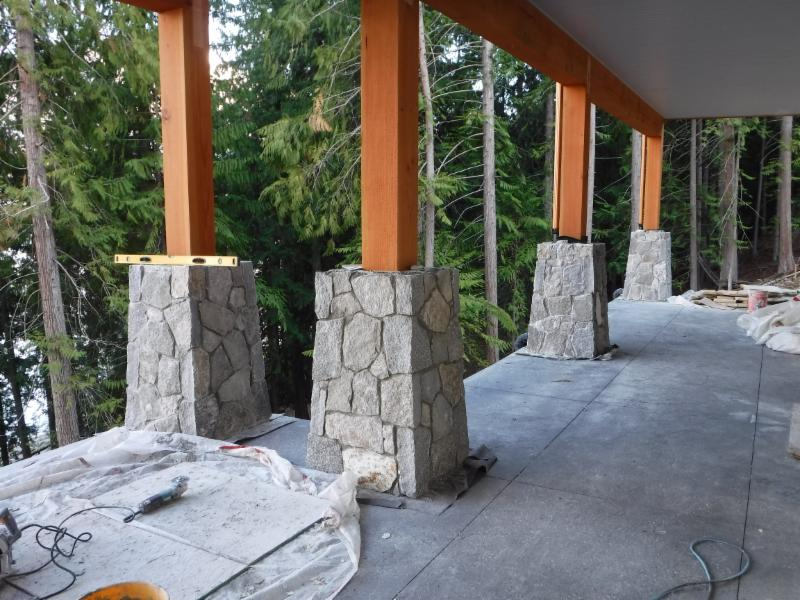 The mass of timber and stone bearing on decorative concrete  creates a feel of solid permanence.