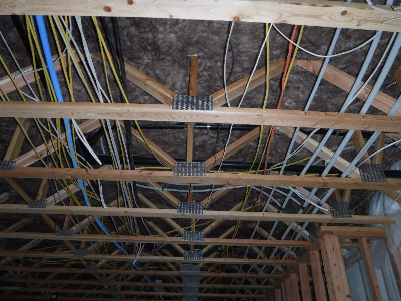 Floor trusses span the entire width of the lower level for a large open  Rec Room, and a chase for all electrical, plumbing, and mechanical.