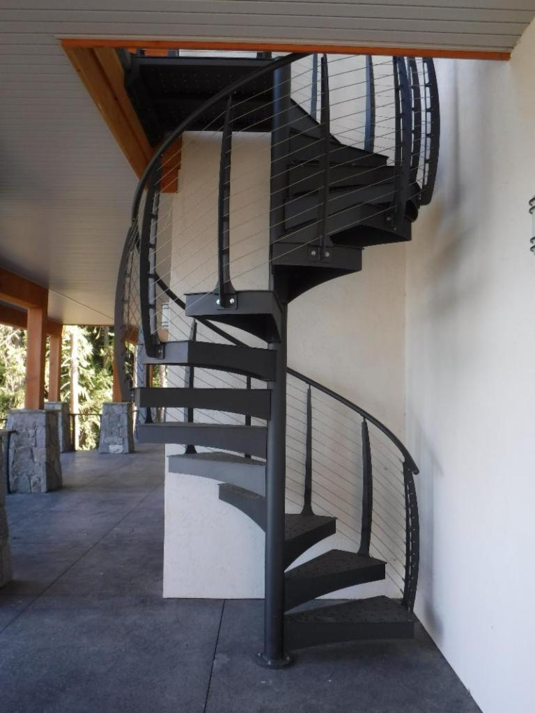 Custom metal spiral stairs provide access to the upper deck.