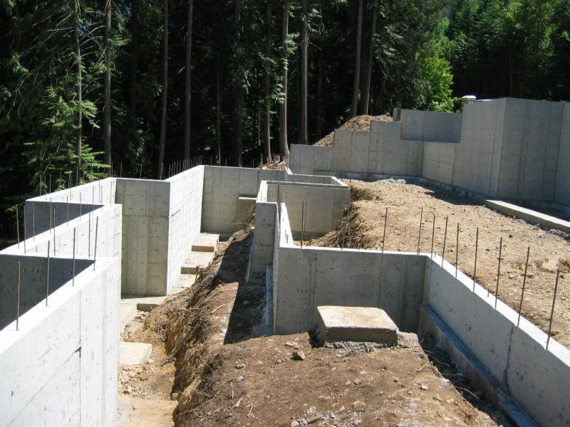 The engineered foundation has over 170 yards of concrete  and several tons of rebar.  Some of the walls are 14 feet tall  and 14 inches thick.