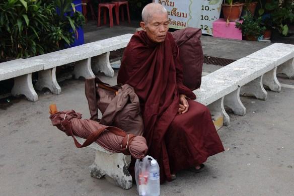 Buddhist monk in silent prayer