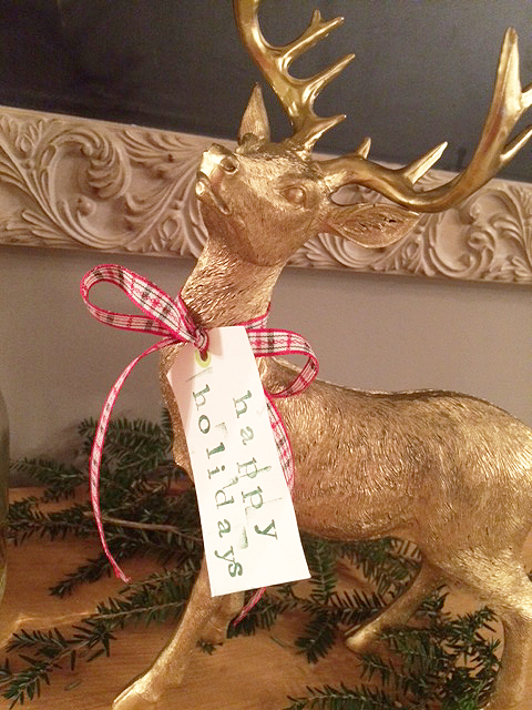 gold reindeer with tag