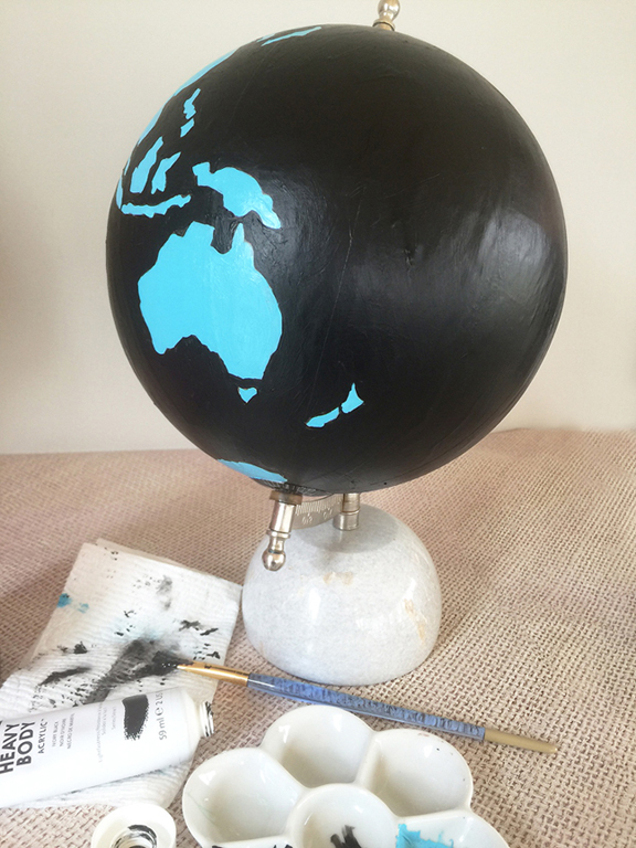 paint an old globe with bold acrylic color paints