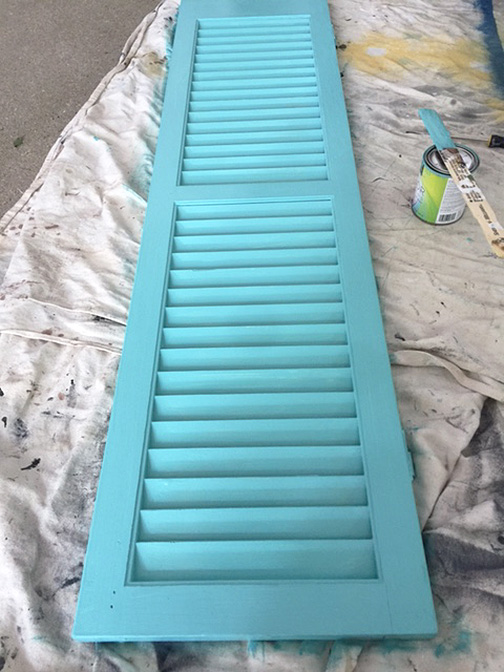 DIY hat hook from an old shutter is just what you need for an inexpensive storage solution and a way to organize all your hats. Benjamin Moore Gulf Stream paint was the perfect color for this piece.