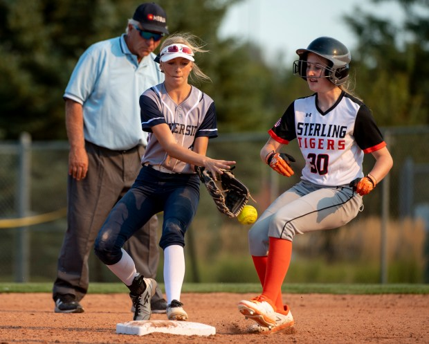GREELEY, CO - SEPTEMBER 03:University centerfielder Kaden Wyatt (13) canÕt quite make the catch to tag out Sterling outfielder Kenzley Palser (30) during a softball game between the University Bulldogs and the Sterling Tigers at Twin Rivers Ball Fields in Greeley Sept. 3, 2020. The Tigers defeated the Bulldogs 6-4. (Alex McIntyre/Staff Photographer)