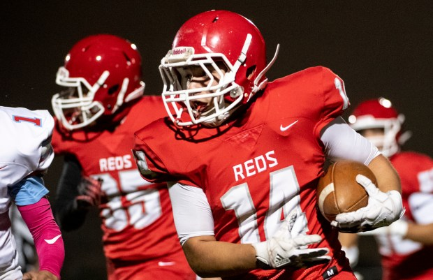EATON, CO - OCTOBER 09:Eaton's Sal Rojas (14) runs during the Eaton Reds football season opener against the Weld Central Rebels at Eaton High School in Eaton Oct. 9, 2020. The Reds defeated the Rebels 49-6. (Alex McIntyre/Staff Photographer)