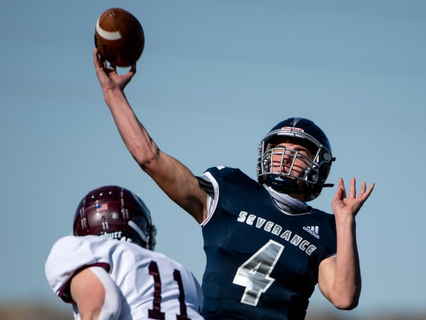 SEVERANCE, CO - OCTOBER 31:Severance's Nolan Hertzke (4) throws a pass under pressure from Berthoud's Austin Burdette (11) during the Severance Silver Knights football game against the Berthoud Spartans at Severance High School in Severance Oct. 31, 2020. The Silver Knights defeated the Spartans 42-6. (Alex McIntyre/Staff Photographer)
