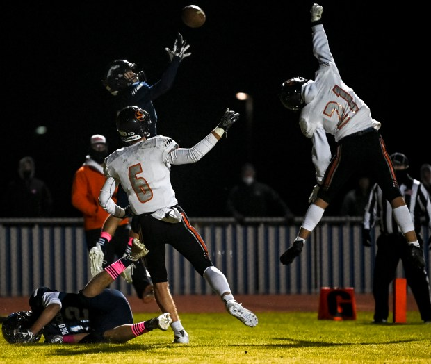 KERSEY, CO - OCTOBER 23:Sterling's Brock Burkholder (21) and Sterling's Jackson Keil (6) break up a pass intended for Platte Valley's Devyn Lauer-Duarte (13) during the Platte Valley Broncos football game against the Sterling Tigers at Platte Valley High School in Kersey Oct. 23, 2020. The Broncos fell to the Tigers 31-21. (Alex McIntyre/Staff Photographer)