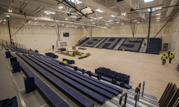 Bleachers go up in the new Severance High School gymnasium on March 15, 2019. (Greeley Tribune file photo)