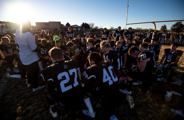 JOHNSTOWN, CO - NOVEMBER 28:Roosevelt head coach Lane Wasinger speaks to his team in the postgame huddle after the Roosevelt Rough Riders won their CHSAA Class 3A state semifinal game against the Pueblo South Colts at Peterson Field at Roosevelt High School in Johnstown Nov. 28, 2020. The Roosevelt Rough Riders defeated the Pueblo South Colts 49-19 to earn a spot in the class 3A state championship game. (Alex McIntyre/Staff Photographer)
