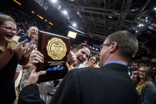 The University Bulldogs bring their trophy back to head coach Justin Kravig during the Class 3A Patriot League Championship girls basketball game between the University Bulldogs and the Eaton Reds at the Budweiser Events Center in Loveland on Feb. 27, 2020. (Greeley Tribune file photo)