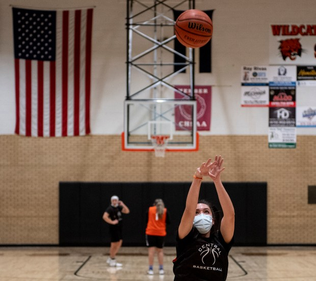 GREELEY, CO - JANUARY 20:Micaela Hidalgo, right, shoots a free throw across the gym from Tathis Arredondo, left, and Kim Arredondo, center, during the Greeley Central Wildcats girls basketball practice at Greeley Central High School in Greeley Jan. 20, 2021. Players and coaches wear masks due to the ongoing COVID-19 pandemic. (Alex McIntyre/Staff Photographer)
