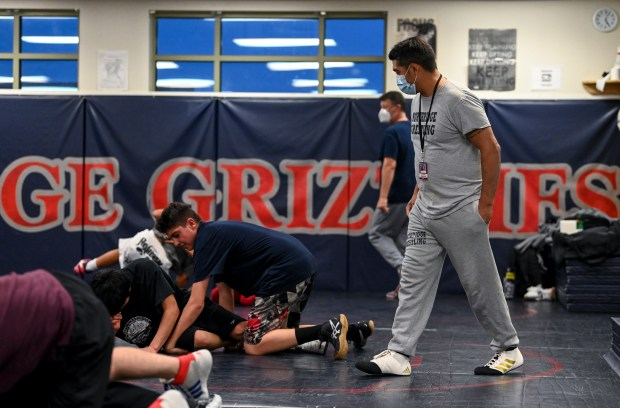 GREELEY, CO - JANUARY 21:Head coach Alfonso Aragon, right, watches his wrestlers during the Northridge Grizzlies wrestling practice at Northridge High School in Greeley Jan. 21, 2021. (Alex McIntyre/Staff Photographer)