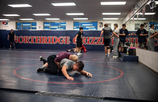 GREELEY, CO - JANUARY 21:Northridge junior Michael Alva, in grey, wrestles with junior Coby Schmidt, in maroon, during the Northridge Grizzlies wrestling practice at Northridge High School in Greeley Jan. 21, 2021. (Alex McIntyre/Staff Photographer)