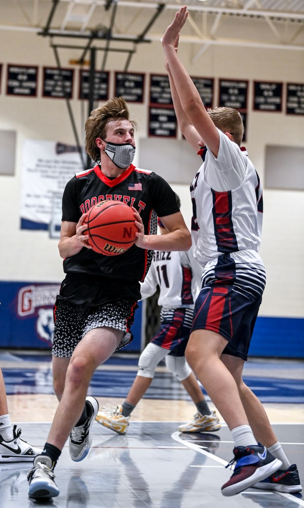 GREELEY, CO - FEBRUARY 09:Roosevelt's Andrew O'Brien (10) makes his approach as Northridge's Cooper Rose (12) defends during the Northridge Grizzlies boys basketball game against the Roosevelt Roughriders at Northridge High School in Greeley Feb. 9, 2021. The Roughriders took down the Grizzlies 58-44.(Alex McIntyre/Staff Photographer)