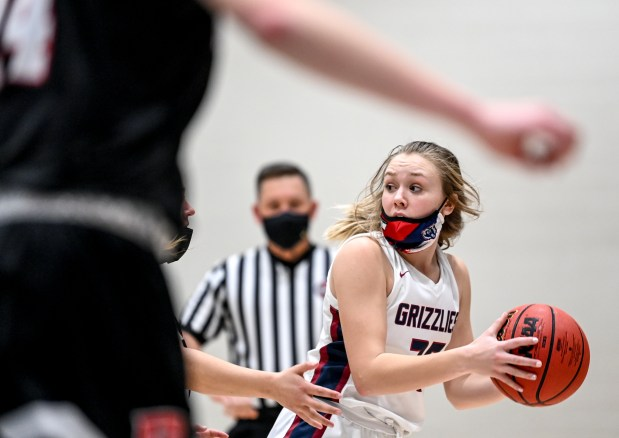 GREELEY, CO - FEBRUARY 09:Northridge's Mckenna Cone (25) looks for an opening during the Northridge Grizzlies girls basketball game against the Roosevelt Roughriders at Northridge High School in Greeley Feb. 9, 2021. The Grizzlies took down the Roughriders 58-53.(Alex McIntyre/Staff Photographer)