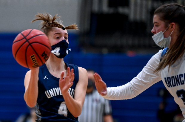 KERSEY, CO - FEBRUARY 13:University's Kylie Kravig (4) passes during the Platte Valley Broncos girls basketball game against the University Bulldogs at Platte Valley High School in Kersey Feb. 13, 2021. The Broncos defeated the Bulldogs 40-36. (Alex McIntyre/Staff Photographer)