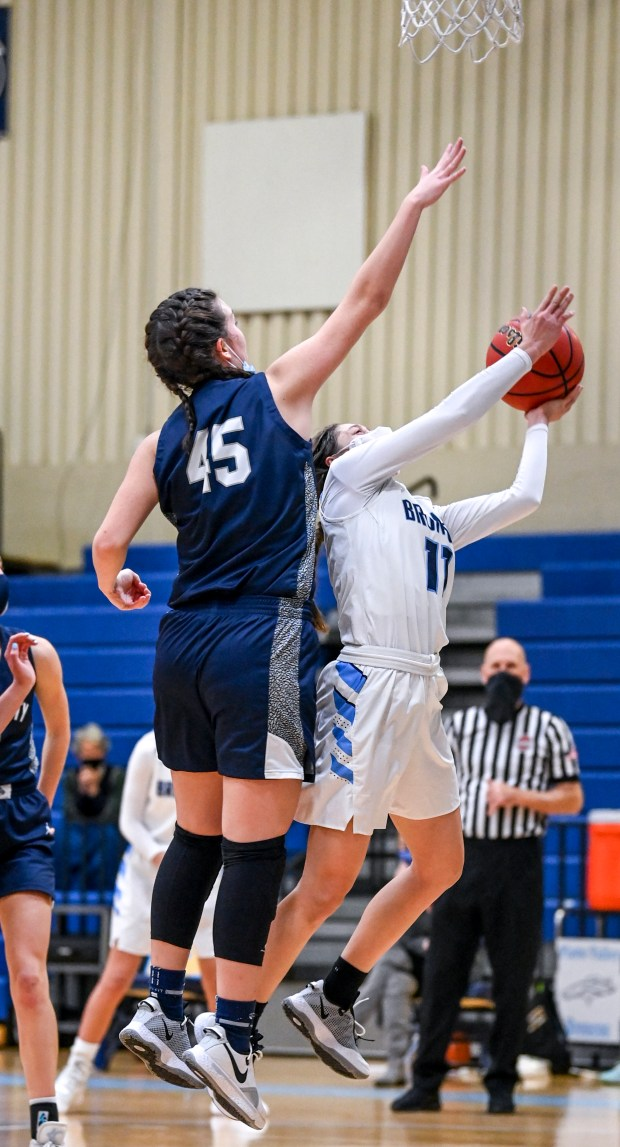 KERSEY, CO - FEBRUARY 13:University's Miranda Wiedeman (45) defends as Platte Valley's Brooke Bunting (11) shoots during the Platte Valley Broncos girls basketball game against the University Bulldogs at Platte Valley High School in Kersey Feb. 13, 2021. The Broncos defeated the Bulldogs 40-36. (Alex McIntyre/Staff Photographer)