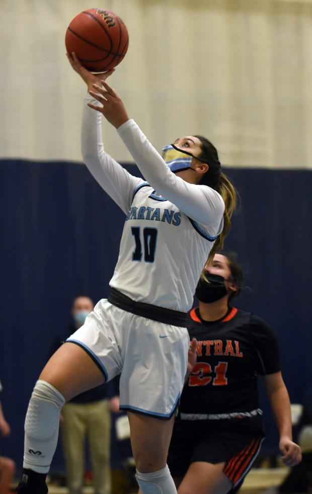 Greeley West's Itzel Guidry goes in for a layup during the game against Greeley Central Monday night at Greeley West High School. (For the Greeley Tribune/Joshua Polson)