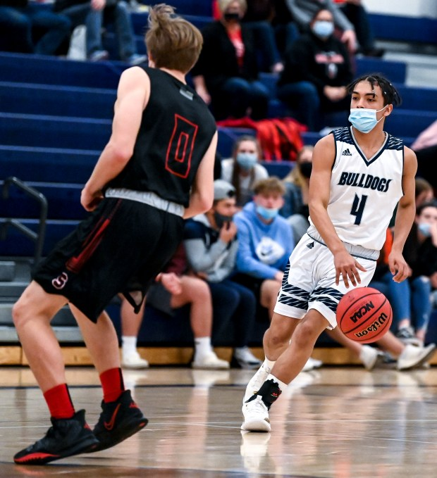 GREELEY, CO - FEBRUARY 26:University's Andrew Mendoza (4) drives down the court as Strasburg's Jake Gilbert (0) defends during the University Bulldogs boys basketball game against the Strasburg Indians at University Middle School in Greeley Feb. 26, 2021. The Bulldogs fell to the Indians 58-47. (Alex McIntyre/Staff Photographer)