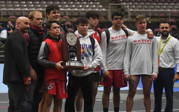The Eaton High School wrestling team celebrates with the second place trophy at the Class 3A state wrestling tournament Friday, March 12, 2021 at the Southwest Motors Events Center in Pueblo. (Austin White/For the Greeley Tribune)