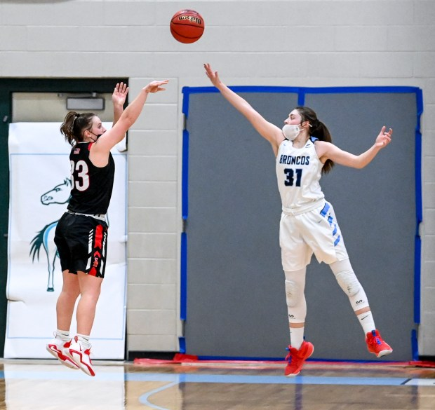 KERSEY, CO - MARCH 03:Eaton's Jennifer Jarnagin (33) sinks a three-pointer over Platte Valley's Bree Bunting (31) to tie the game 46-46 late in overtime during the Platte Valley Broncos girls basketball game against the Eaton Reds at Platte Valley High School in Kersey March 3, 2021. The Broncos took down the Reds 47-46 in overtime. (Alex McIntyre/Staff Photographer)