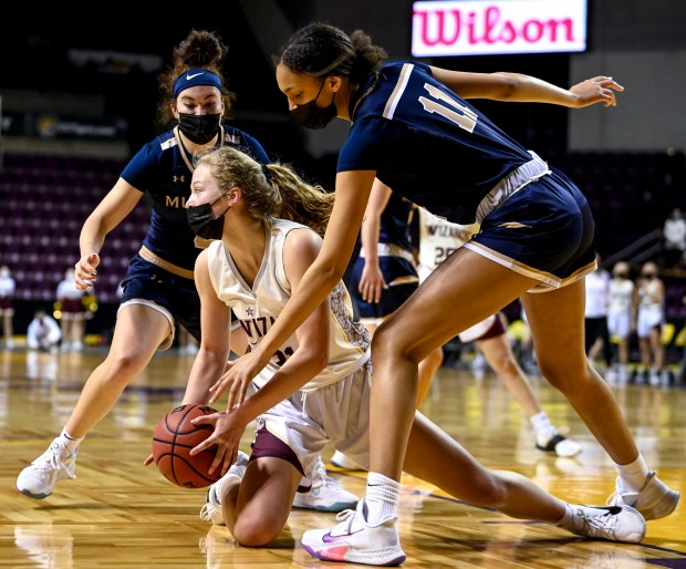 COLORADO SPRINGS, CO - MARCH 21:Windsor's Olivia Reed (31) falls to the floor as she is boxed in by Mullen's Imani Perez (11) and Mullen's Alexa Dominguez (4) during the Windsor Wizards CHSAA Class 4A girls basketball state championship game against the Mullen Mustangs at The Broadmoor World Arena in Colorado Springs March 21, 2021. The Wizards fell to the Mustangs 67-44. (Alex McIntyre/Staff Photographer)