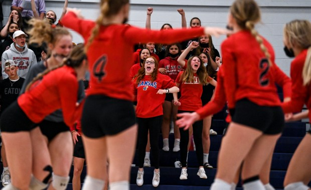 GREELEY, CO - APRIL 06:The Eaton Reds student section reacts as the Reds win their second set against the Bulldogs during the University Bulldogs volleyball game against the Eaton Reds at University Middle School in Greeley April 6, 2021. The Reds defeated the Bulldogs 3-1. (Alex McIntyre/Staff Photographer)