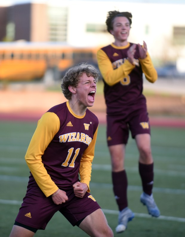 AURORA, CO - APRIL 28:Windsor's Seth Ellingson (11) screams in celebration with Trevor Davis after winning their 4A boys soccer semifinal match against the Niwot Cougars at Legacy Stadium in Aurora April 28, 2021. The Wizards defeated the Cougars 2-1 and will advance to the state championship match on Saturday. (Joshua Polson for the Greeley Tribune)