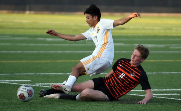 GREELEY, CO - APRIL 05:Greeley Central's Casey Hawkins slide tackles into Greeley West's Juan Cortes during the game Monday night at District 6 Stadium in Greeley. (Joshua Polson for the Greeley Tribune)