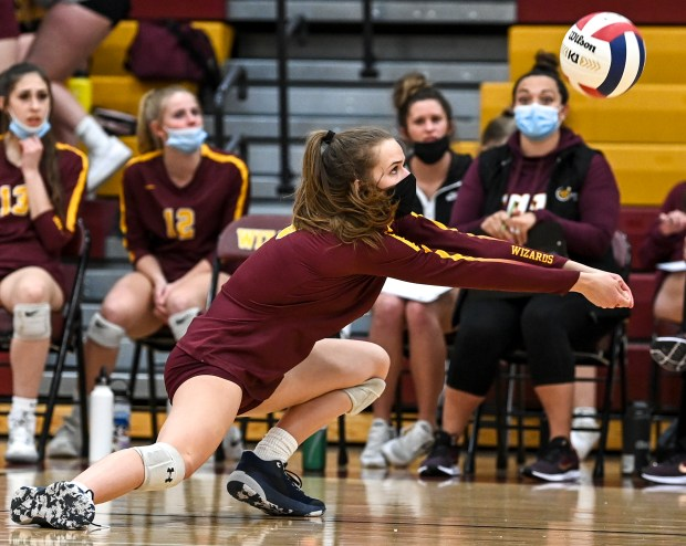 WINDSOR, CO - APRIL 14:Windsor's Julia Bohlinger (6) digs during the Windsor Wizards volleyball match against the Riverdale Ridge Ravens at Windsor High School in Windsor April 14, 2021. The Wizards defeated the Ravens in 3 sets.(Alex McIntyre/Staff Photographer)