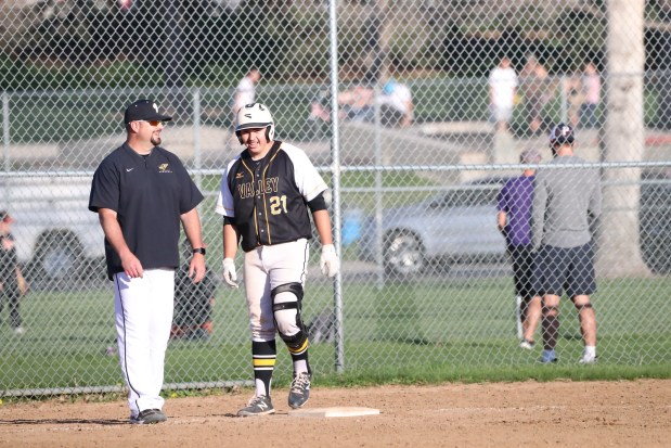 Valley senior Brandon Blanco, right, converses with Vikings coach Steve Kissler after Blanco reaches base during Valley's 16-9 win against Liberty Common on Thursday, May 6, in Fort Collins. (Courtesy/Brian Stotts)