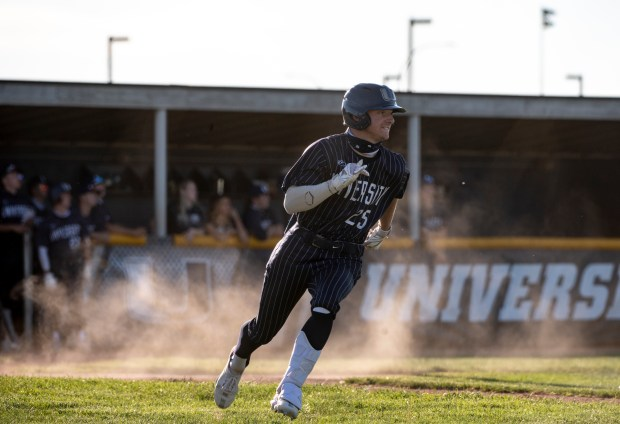 GREELEY, CO - MAY 27:University's Nolan Johnson (25) runs toward first during the Eaton Reds baseball game against the University Bulldogs at University High School in Greeley May 27, 2021. The Reds defeated the Bulldogs 12-5. (Alex McIntyre/Staff Photographer)