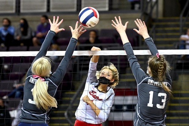 COLORADO SPRINGS, CO - MAY 13:Eaton's Ahana Leffler (1) attacks as University's Taylor Viken (3) and University's Katie Bauer (13) leap to block during the Eaton Reds 3A girls volleyball state semifinal match against the University Bulldogs at The Broadmoor World Arena in Colorado Springs May 13, 2021.(Alex McIntyre/Staff Photographer)