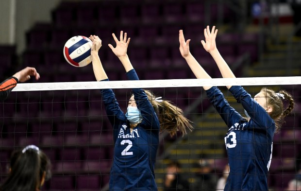 COLORADO SPRINGS, CO - MAY 12:University's Logan Conlin (2) and University's Katie Bauer (13) leap to block during the University Bulldogs 3A girls volleyball state quarterfinal match against the Lamar Savages at The Broadmoor World Arena in Colorado Springs May 12, 2021. The University Bulldogs defeated the Lamar Savages 3-1 and will advance to the semifinals. (Alex McIntyre/Staff Photographer)