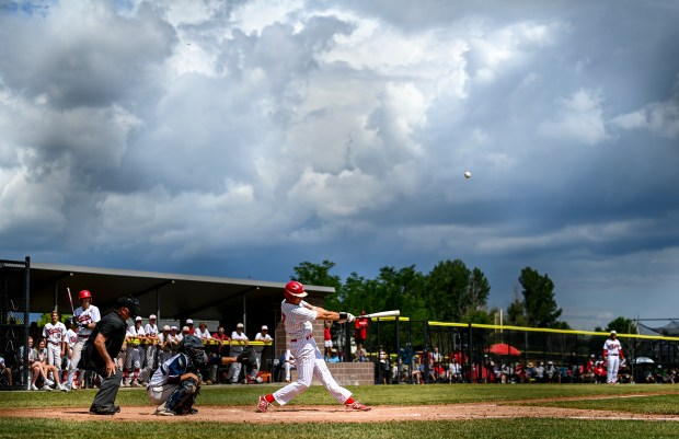 FREDERICK, CO - JUNE 26:Eaton's Ryan Ure (17) hits a fly ball that is caught for an out in the outfield during the Eaton Reds 3A baseball state final game against the The Classical Academy Titans at Frederick High School in Frederick June 26, 2021. A lightning delay paused the game in the bottom of the 5th inning as Eaton sat ahead of The Classical Academy, 3-0. (Alex McIntyre/Staff Photographer)
