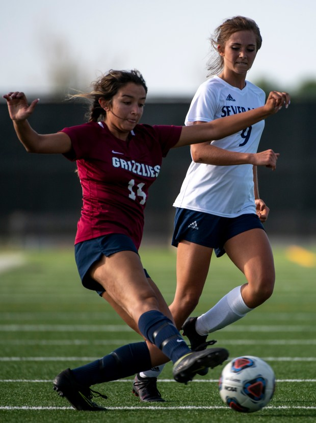GREELEY, CO - JUNE 08:Northridge's Madi Roberts (14) tries to stay ahead of Severance's Joslin Edman (9) during the Northridge Grizzlies girls soccer match against the Severance Silver Knights at District 6 Soccer Stadium in Greeley June 8, 2021. The Grizzlies defeated the Silver Knights 10-0. (Alex McIntyre/Staff Photographer)