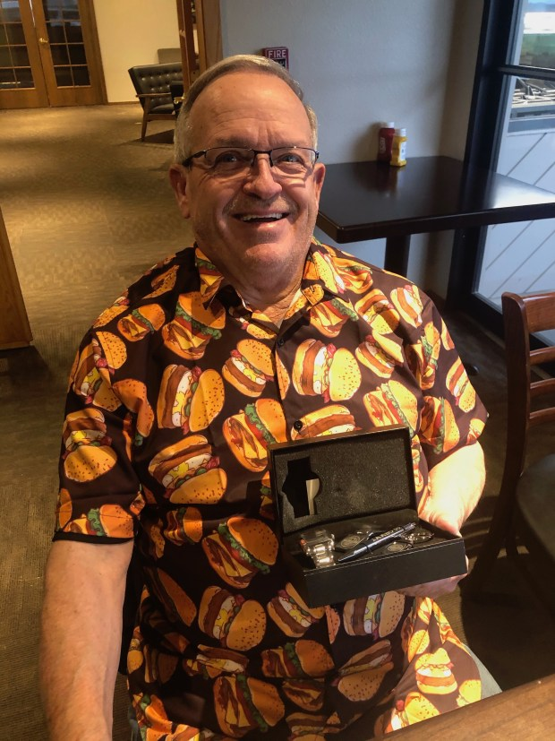 On May 3, Thomas Gallatin was recognized by the International Association of Approved Basketball Officials for 50 years of service. The IAABO presented him with a commemorative watch, pen, money clip and keychain. And, his coaching colleagues gave him a cheeseburger-clad button-up shirt. (Courtesy/Jim Kerr)