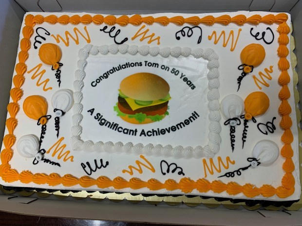 Tom Gallatin received a decorative cake on May 3 while being recognized by the International Association of Approved Basketball Officials for 50 years of service. (Courtesy/Tom Gallatin)