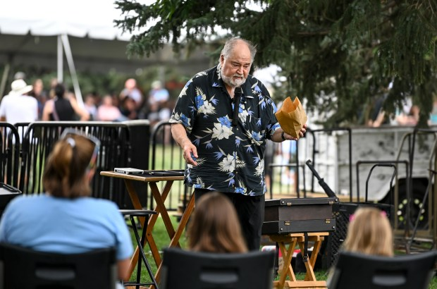 GREELEY, CO - JULY 24:A magician performs a magic show for families during the 2021 Greeley Arts Picnic at Lincoln Park in downtown Greeley July 24, 2021. The event, canceled in 2020 due to the COVID-19 pandemic, features artists, food and drink vendors, performances for adults and kids and more. (Alex McIntyre/Staff Photographer)