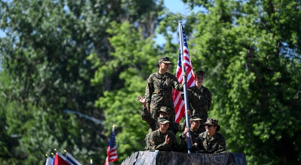 GREELEY, CO - JULY 03:Northridge High School MJROTC members ride a float during the Independence Day Parade in Greeley July 3, 2021. The parade, held on July 3 this year because the 4th fell on a Sunday, draws thousands to watch each year. (Alex McIntyre/Staff Photographer)