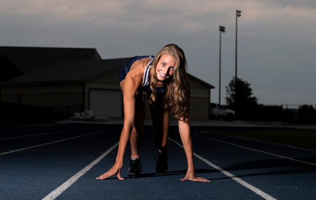 GREELEY, CO - JULY 14:University graduating senior Kylie Kravig poses in a ready stance for a portrait on the track at Tom Roche Field at University Schools in Greeley July 14, 2021. Kravig, who plays girls basketball and competes in both track and cross country, is the Greeley Tribune's 2021 Girls Athlete of the Year. (Alex McIntyre/Staff Photographer)