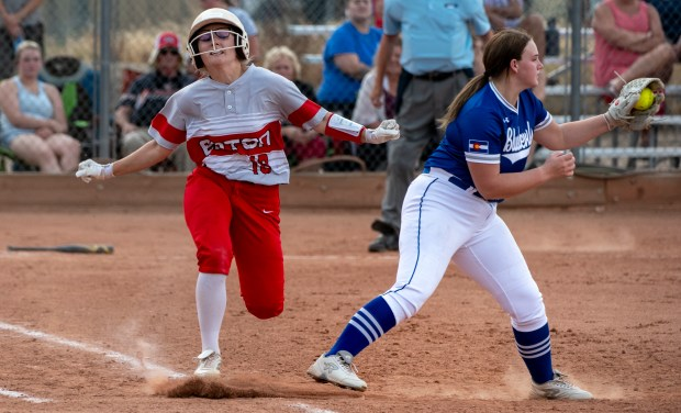 EATON, CO - AUGUST 17:Eaton's Stephanie Bingley (18) reacts as Fort Lupton's Gracie Brucato (13) makes the catch to tag her out at first base during the Eaton Reds softball game against the Fort Lupton Bluedevils at Eaton High School in Eaton Aug. 17, 2021. The Eaton Reds defeated the Fort Lupton Bluedevils 6-1. (Alex McIntyre/Staff Photographer)